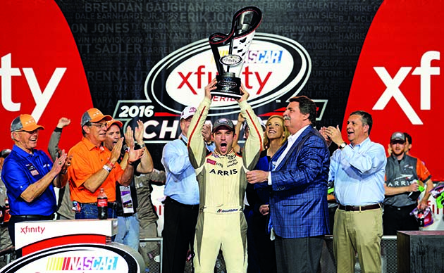 HOMESTEAD, FL - NOVEMBER 19:  Daniel Suarez, driver of the #19 ARRIS Toyota, celebrates with the NASCAR XFINITY Series Championship trophy in Victory Lane after winning the NASCAR XFINITY Series Ford EcoBoost 300 and the NASCAR XFINITY Series Championship at Homestead-Miami Speedway on November 19, 2016 in Homestead, Florida.  (Photo by Robert Laberge/Getty Images)