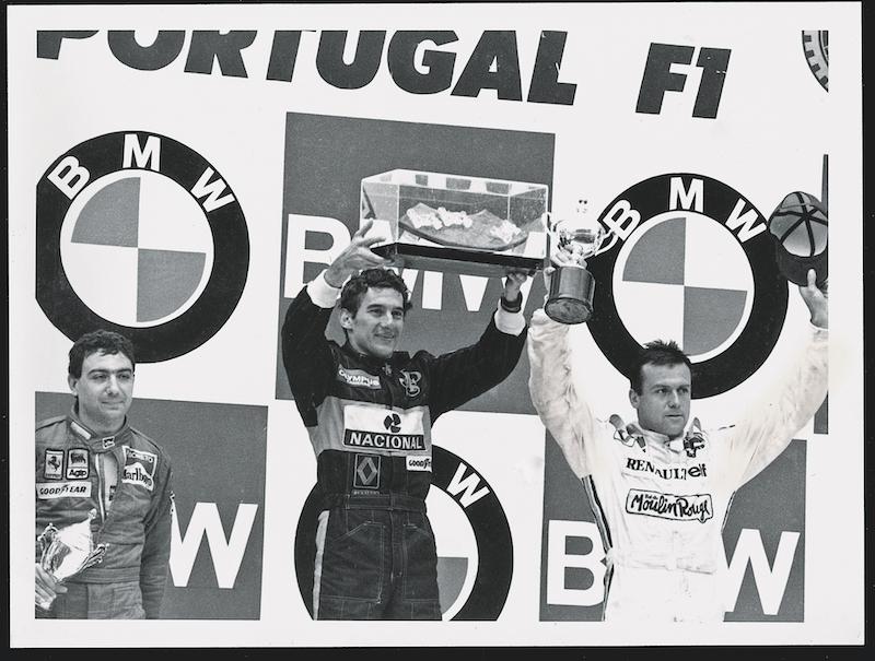 La primera victoria de F1 en Portugal 1985, en el podio con Alboreto y Tambay.